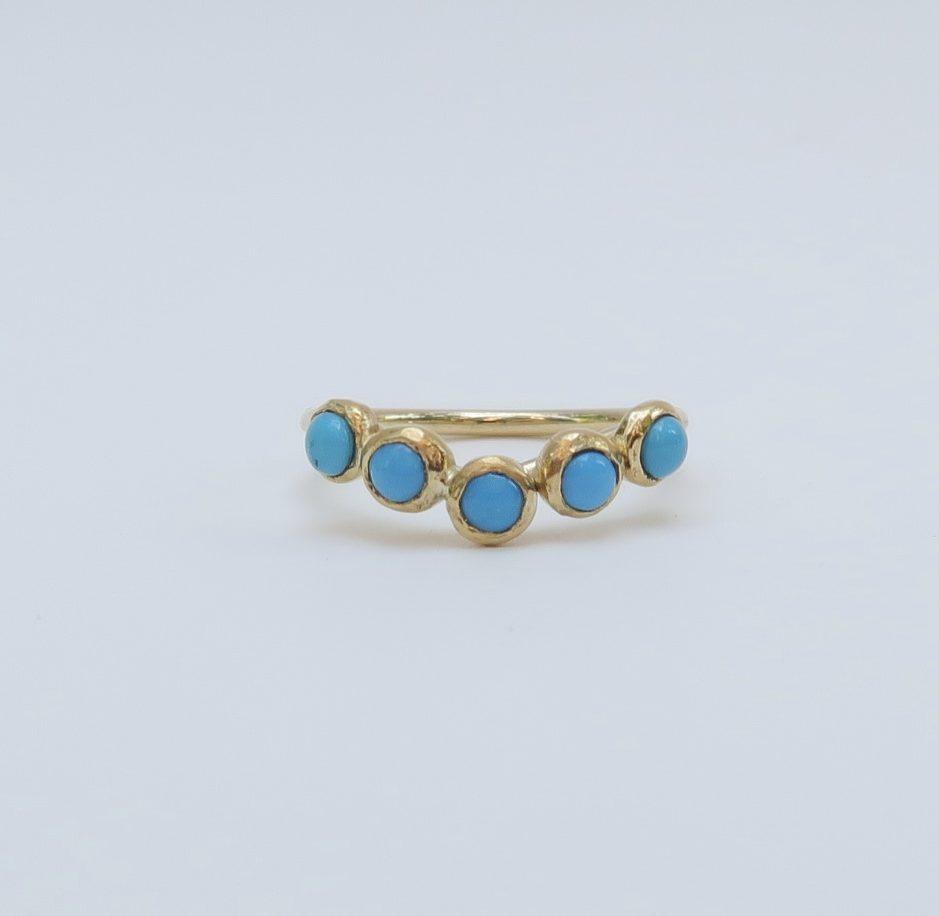 geelgouden ring met rij van turkoois edelstenen